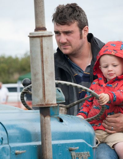 Dad and son on tractor